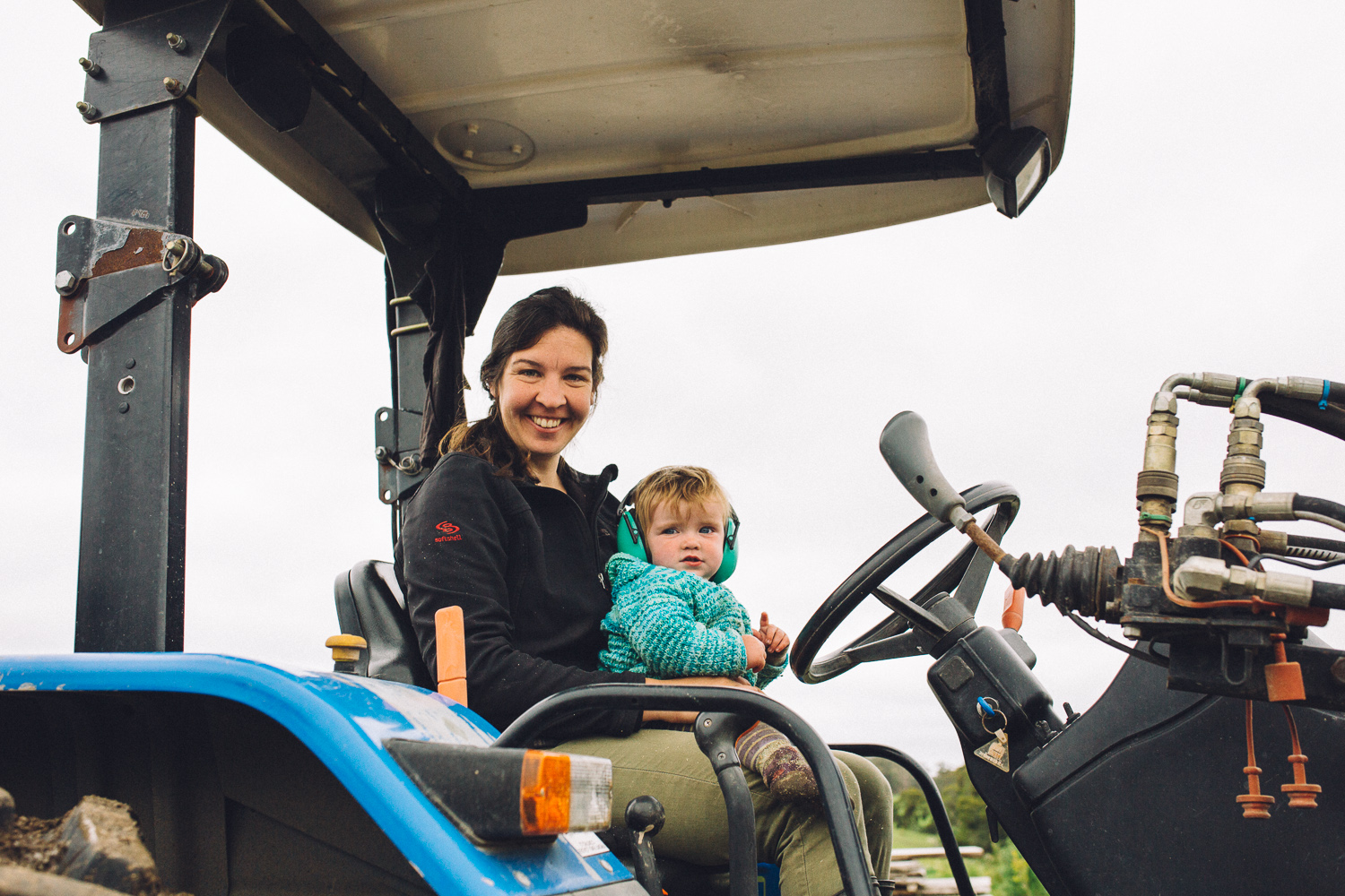 Amelia Bright sitting with her daughter Hazel in a tractor, Amber Creek Farm, Fish Creek, 2016. Source: Museums Victoria, Photographer: Catherine Forge