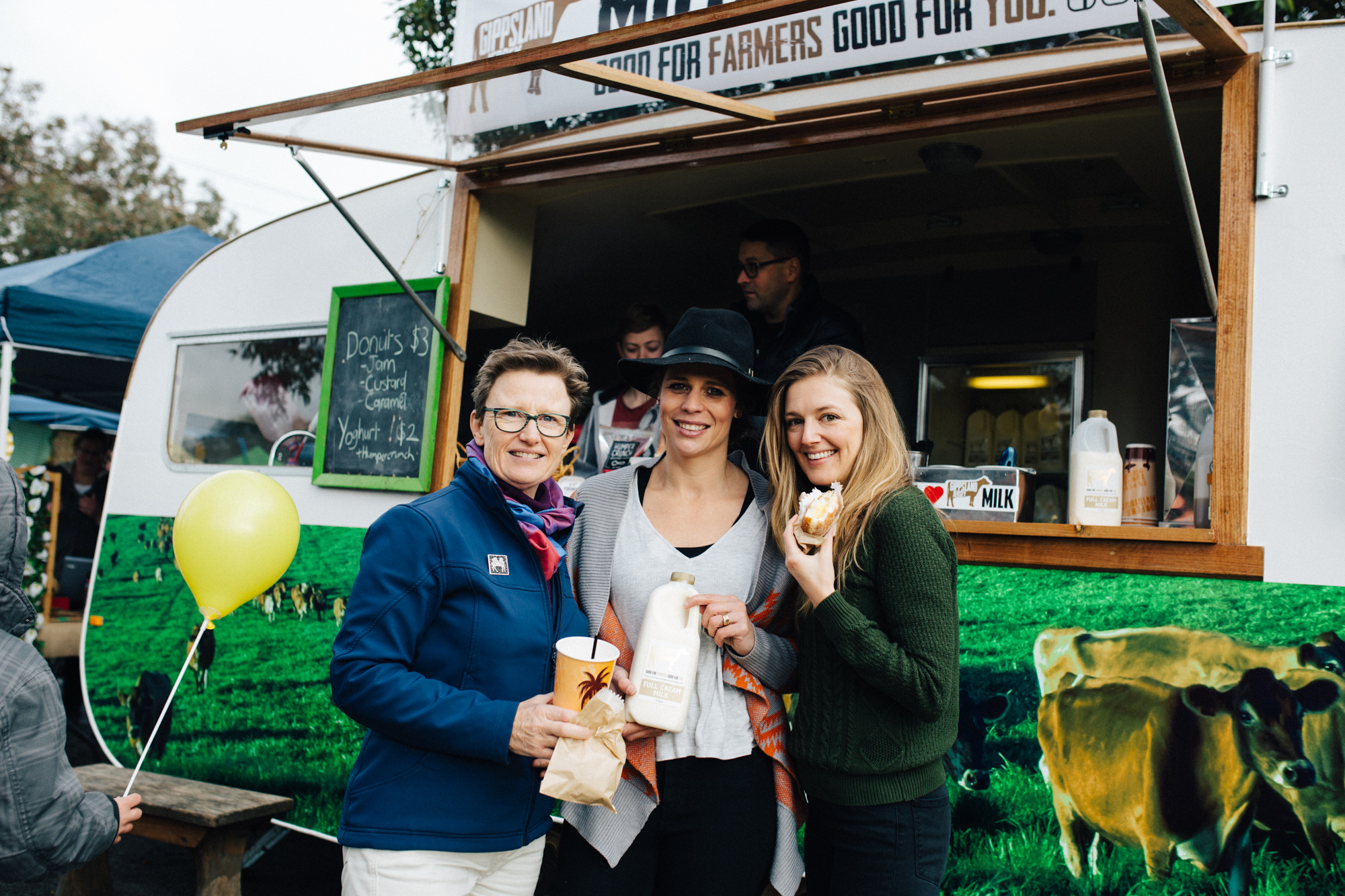 Liza Dale-Hallett (left) with farmer Sallie Jones (centre) from Gippsland Jersey and Invisible Farmer Project curator Catherine Forge (right) at the Warragul Farmers Markets, July 2017, Supplied: Robert Zugaro
