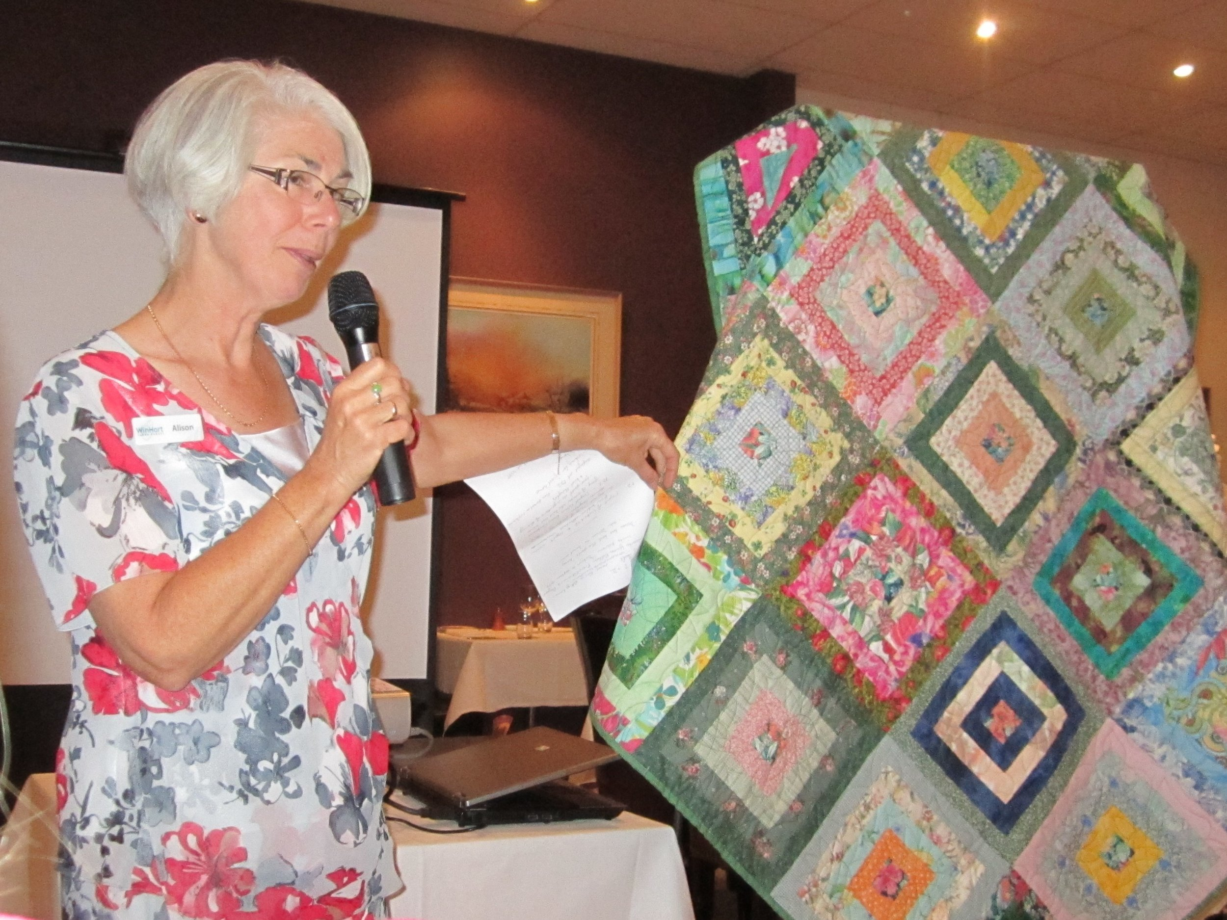 Alison Brinson with the Singed Sisters and Solidarity and Friendship Quilt, 2011, image supplied.