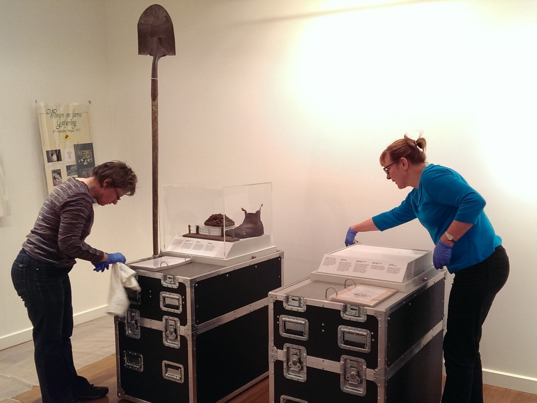 Liza Dale-Hallett (left) with Ilse Matthews (right) setting up Women on Farms Gathering Heritage exhibition items, 2015, image supplied.