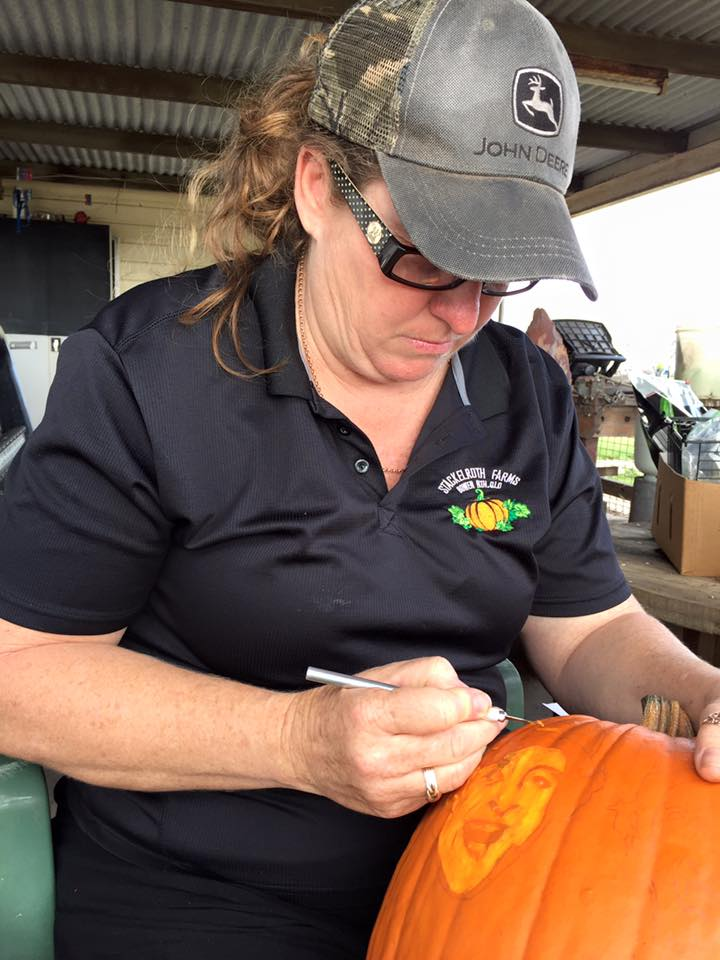 Michelle carving Halloween pumpkins, image supplied (Stackelroth Farms, Facebook).