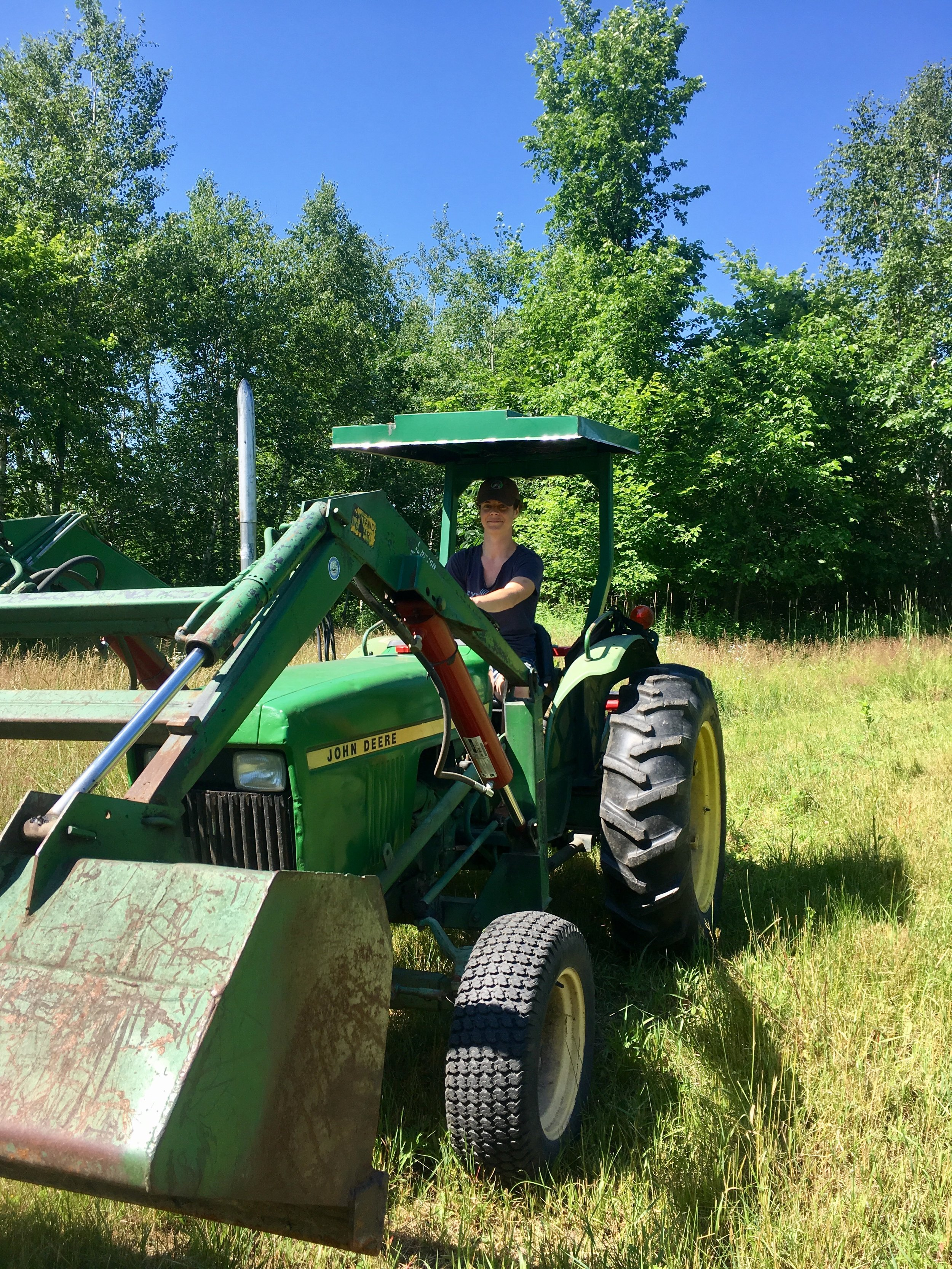 Jaclyn working on a tractor, Minnesota, 2017, image supplied.