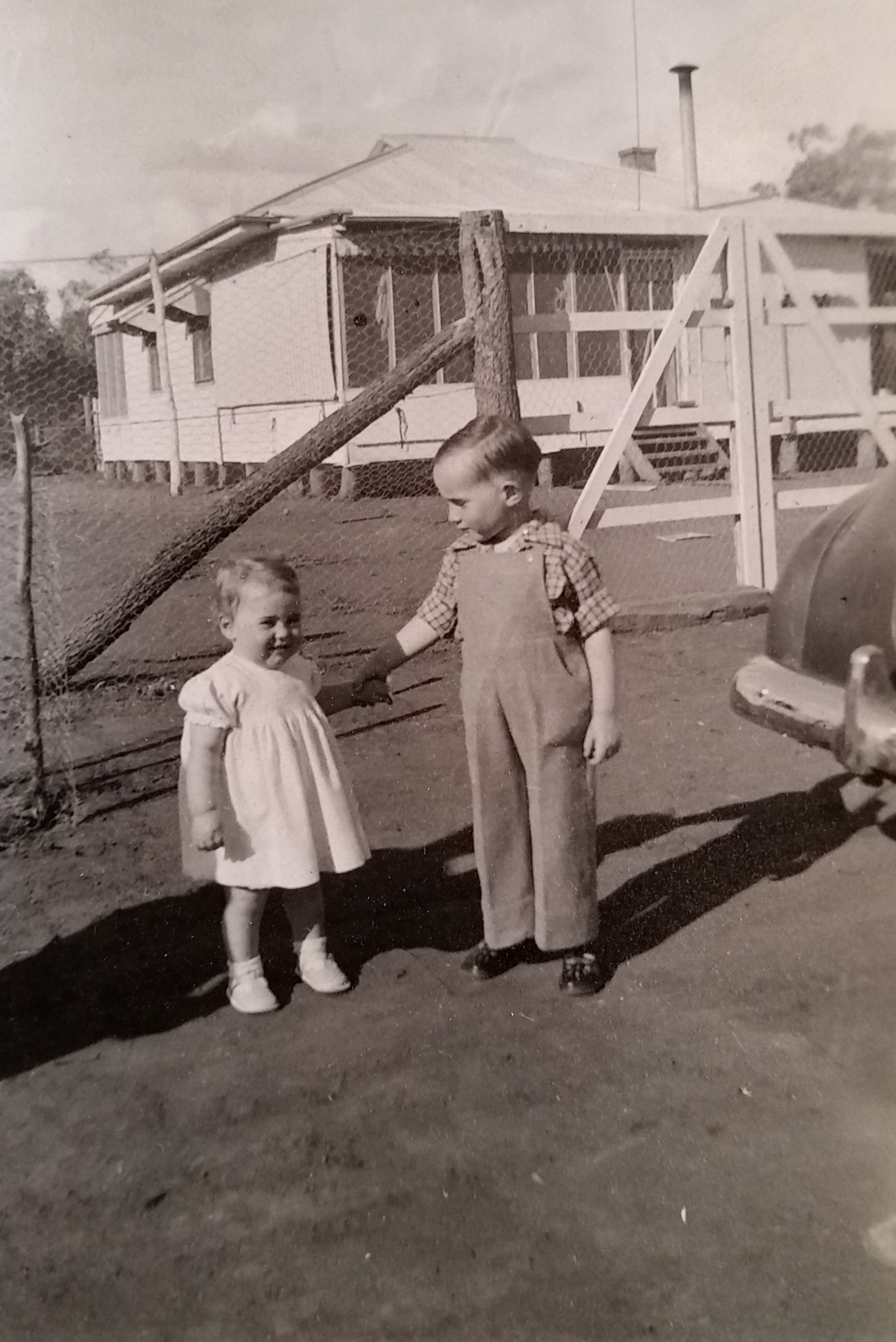 Lisa's father Chris Stanmore with his sister Jenny outside the old Eurella homestead, c. 1957, image supplied.