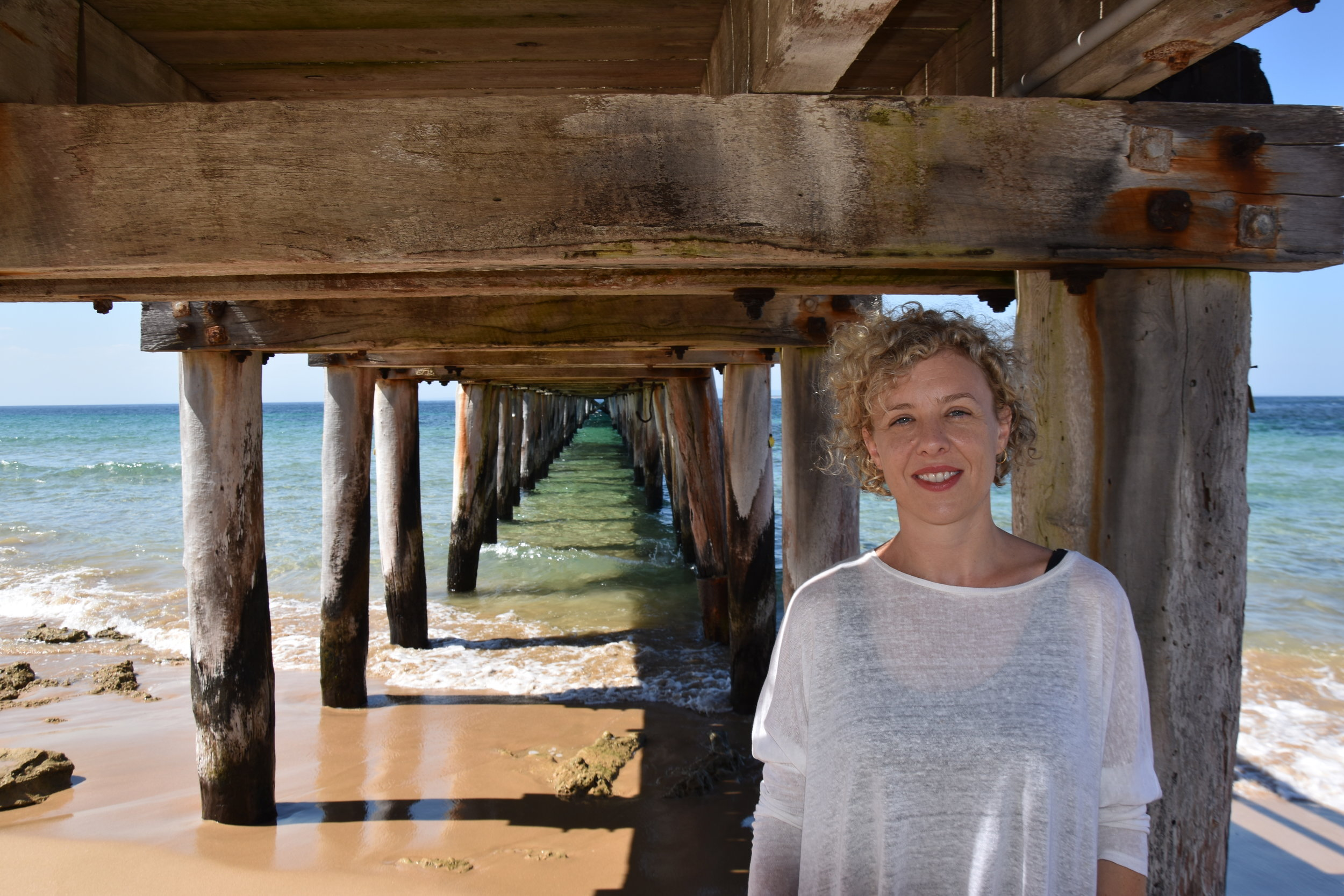 Kirsten under Point Lonsdale Pier, near her parent's house, at the heads to Port Phillip Bay, 2017, image supplied.