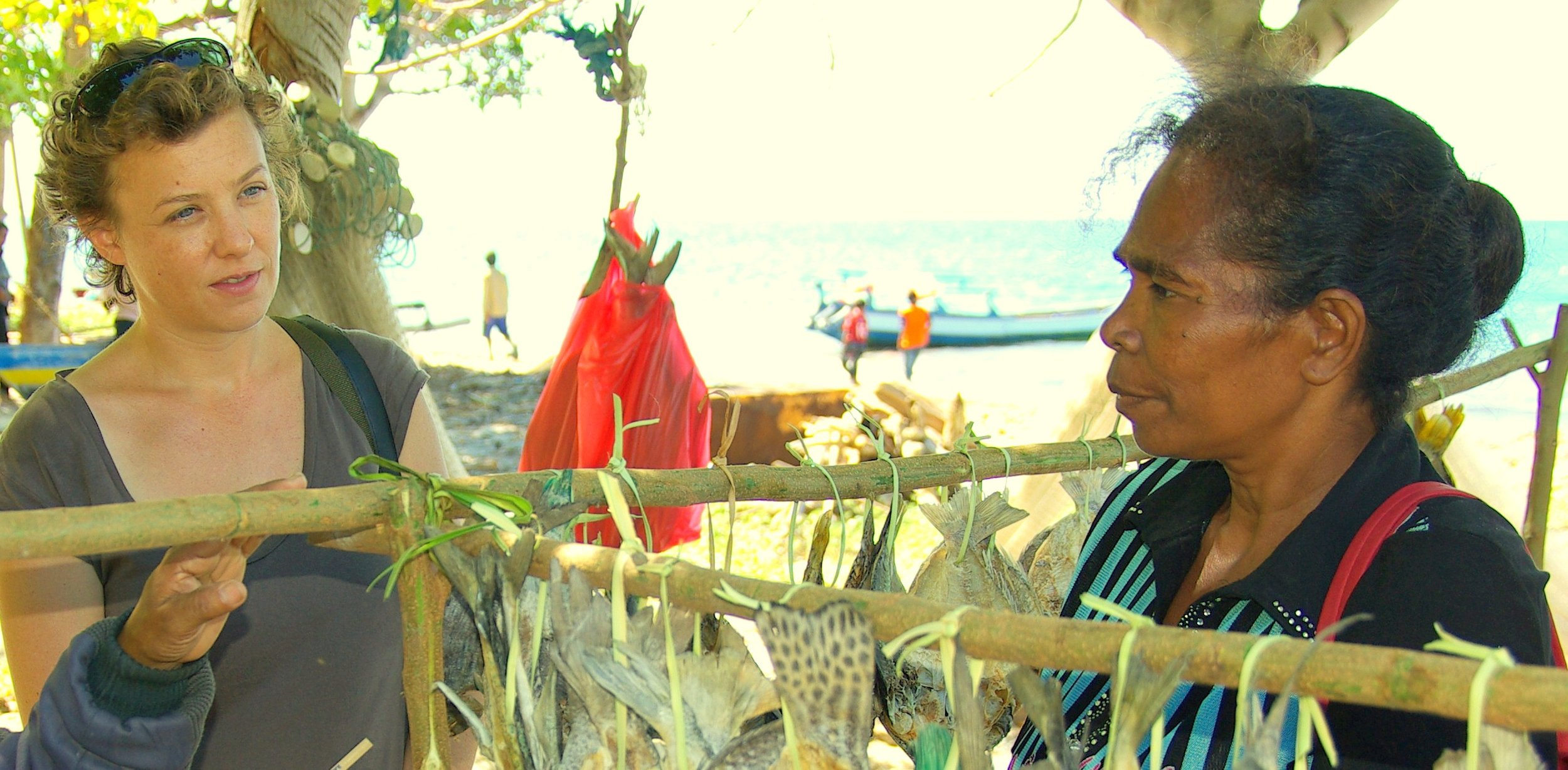 Kirsten on Ataúro Island, Timor-Leste, in 2012, pictured alongside a local woman selling dried fish. During her time at Timor-Leste, Kirsten worked with a research and development organisation called 'WorldFish' that aimed to better understand the role of women in fisheries and their participation in governance systems, image supplied.