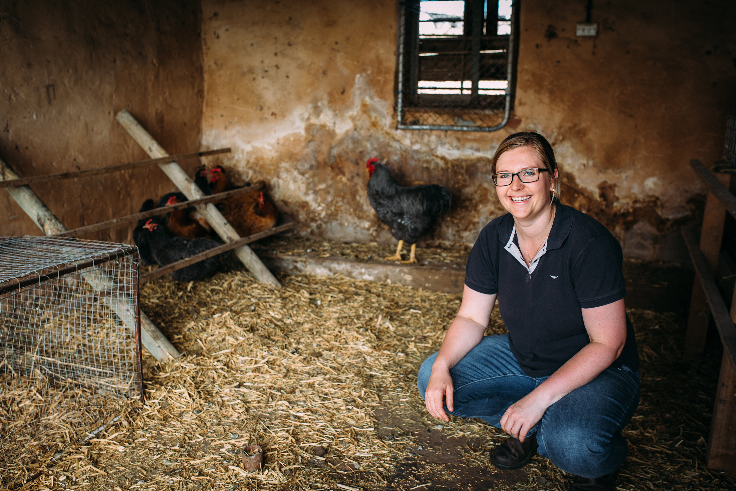 Emily Mueller feeding the chooks, Murray Bridge, South Australia, photographed by Catherine Forge, Source: Museums Victoria: https://collections.museumvictoria.com.au/items/2243781