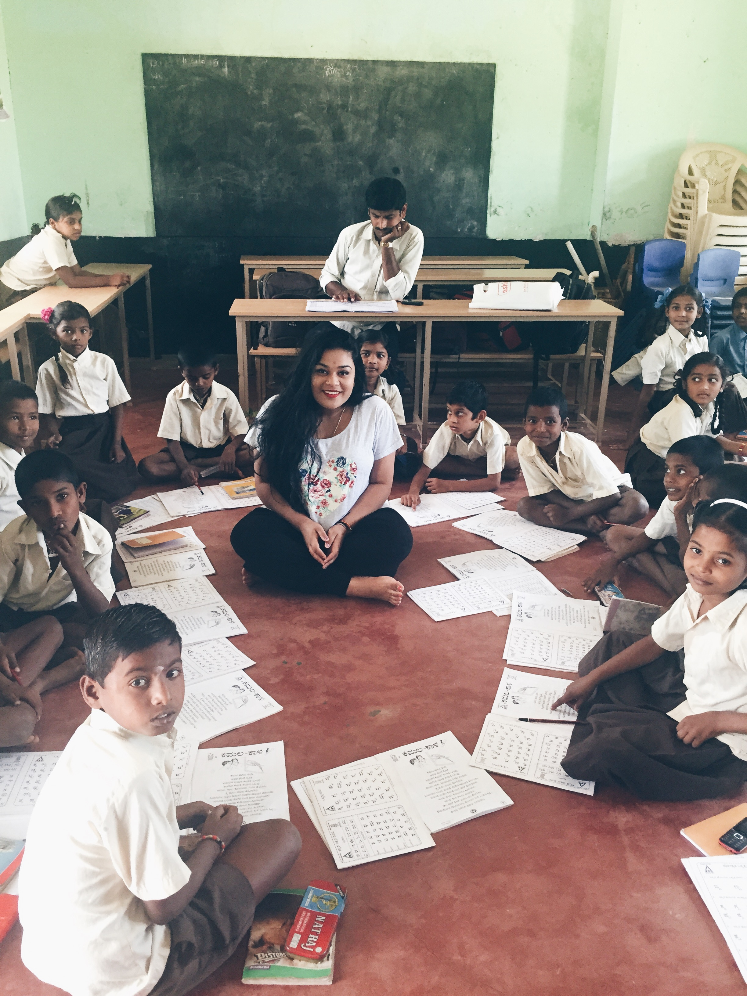 Rayali teaching students English in a classroom in Bangalore.
