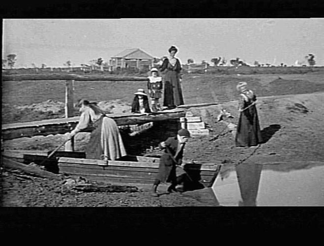 Women and children working on irrigation channels near Shepparton in the small town of Merrigum, circa 1910-1920. Source: Museums Victoria:  https://collections.museumvictoria.com.au/items/765157
