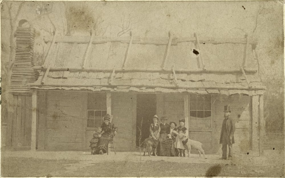 Mrs Kelly and family group outside the Kelly homestead, ca 1881. Source: State Library of Victoria.