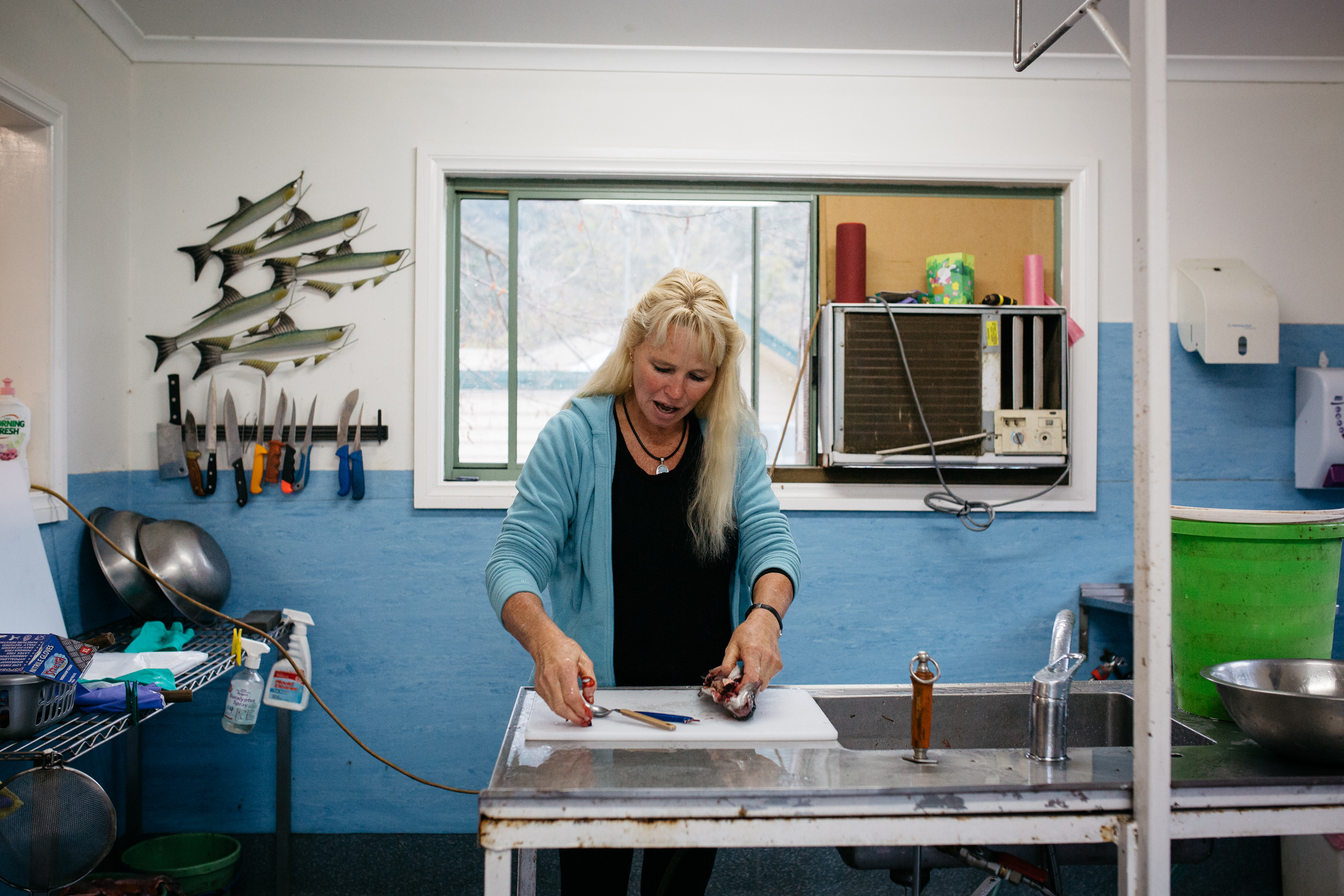 Sally Hall preparing fish in her Farm Gate shop, Mountain Fresh Trout and Salmon Farm, Harrietville (Victoria), 2017, Photographer: Catherine Forge, Source: Museums Victoria.