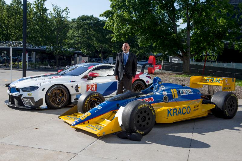 Bobby Rahal, with two cars representing his career. The 2018 BMW Team RLL BMW M8GTE, and the 1989 Lola T8900 Cosworth Indy car he raced. Brian Cleary photo.