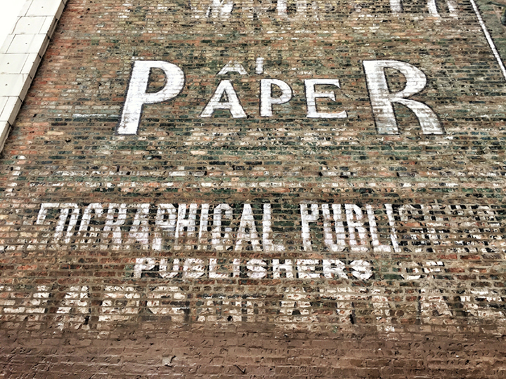 Close up of ghost sign on the side of the Lightner Building.