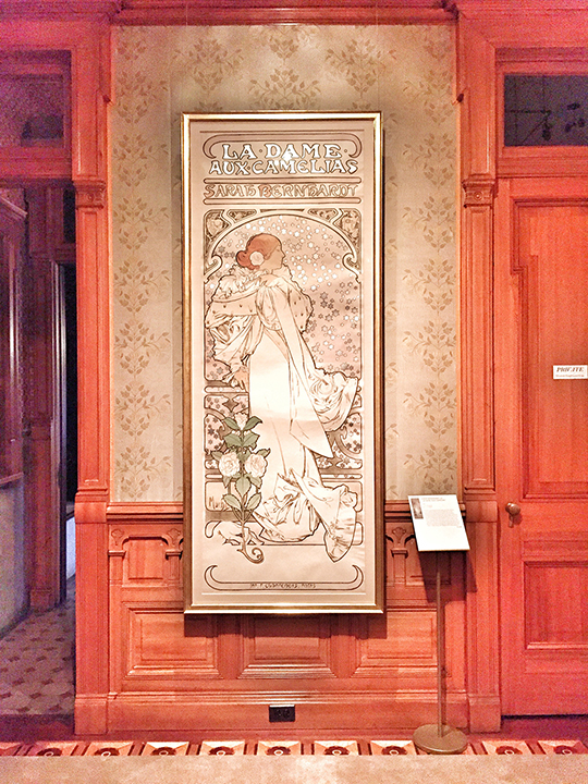 "Mucha, Sarah Bernhardt as 'La Dame Aux Camelias', color lithograph, 1896. According to the Driehaus Museum placard, ""This collector's version of the poster lacks the lettering at the bottom that would later be imprinted with the name of the venue, the Theatre de la Renaissance.' I LOVE the tall, narrow format and the muted colors."