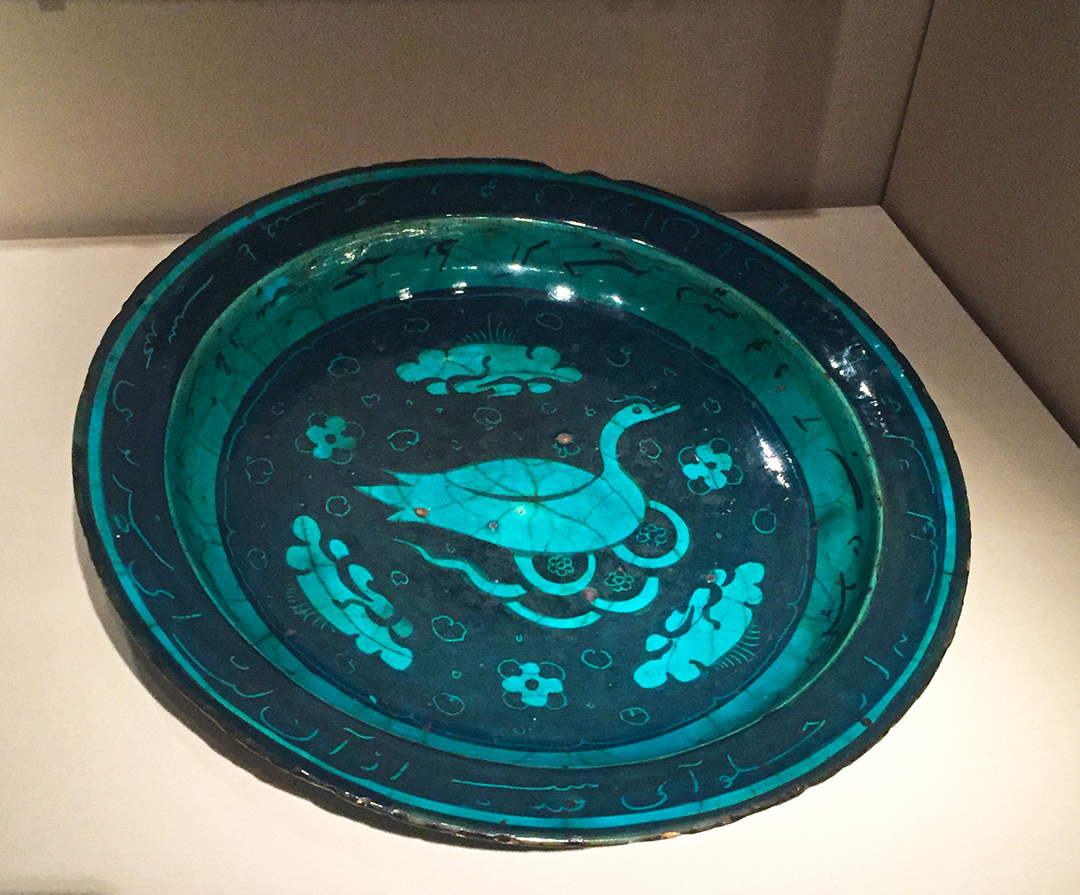 Bowl, late 15th century, Timurid Dynasty (1370-1507), Iran. Fritware, painted in black under a transparent turquoise glaze.