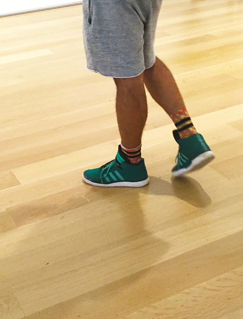 Sexy beast wearing green Adidas mid-top's ... I'm still researching. Hi.