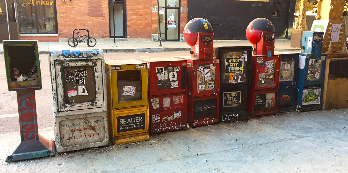 Newspaper boxes at the Damen Blue Line train stop, Wicker Park, Chicago, IL