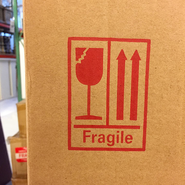 Fragile looking Fragile font; the cracked wine glass seems to be the consistent image for the FRAGILE stickers.