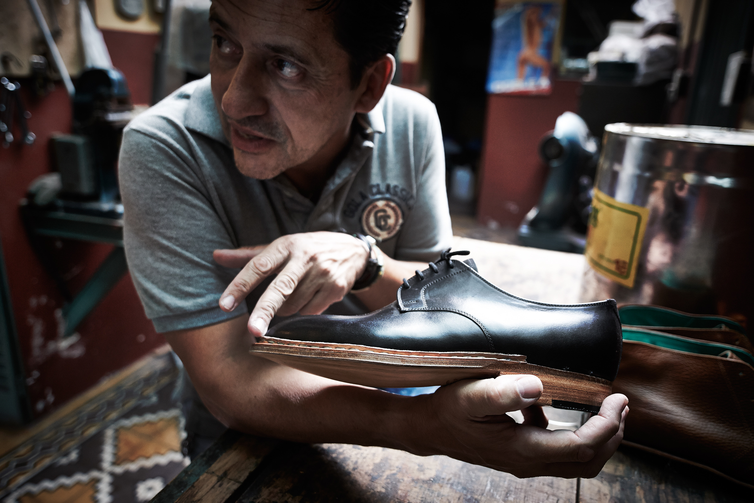 Dani with one of a half-made pair of shoes, Buenos Aires, Argentina (Photo: Anatol Kotte/The Other Hundred)