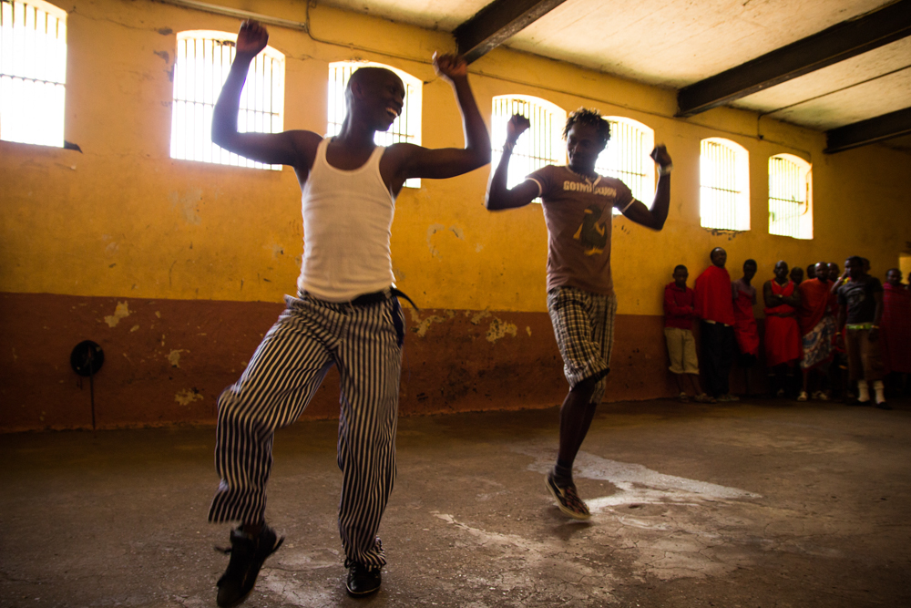 Rona (right) rehearses with one of the members of his dance crew before a crowd of fellow detainees.
