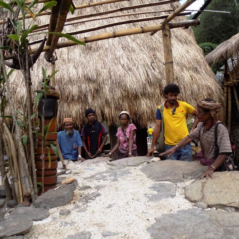 In Atabae, a village in western Timor-Leste, a traditional sea-salt maker explains the ways of his craft to Pedro (second right).
