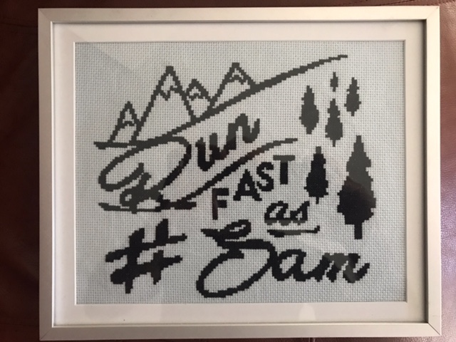 A needlepoint made by one of Sam's November Project mates, gifted to Richard Dweck