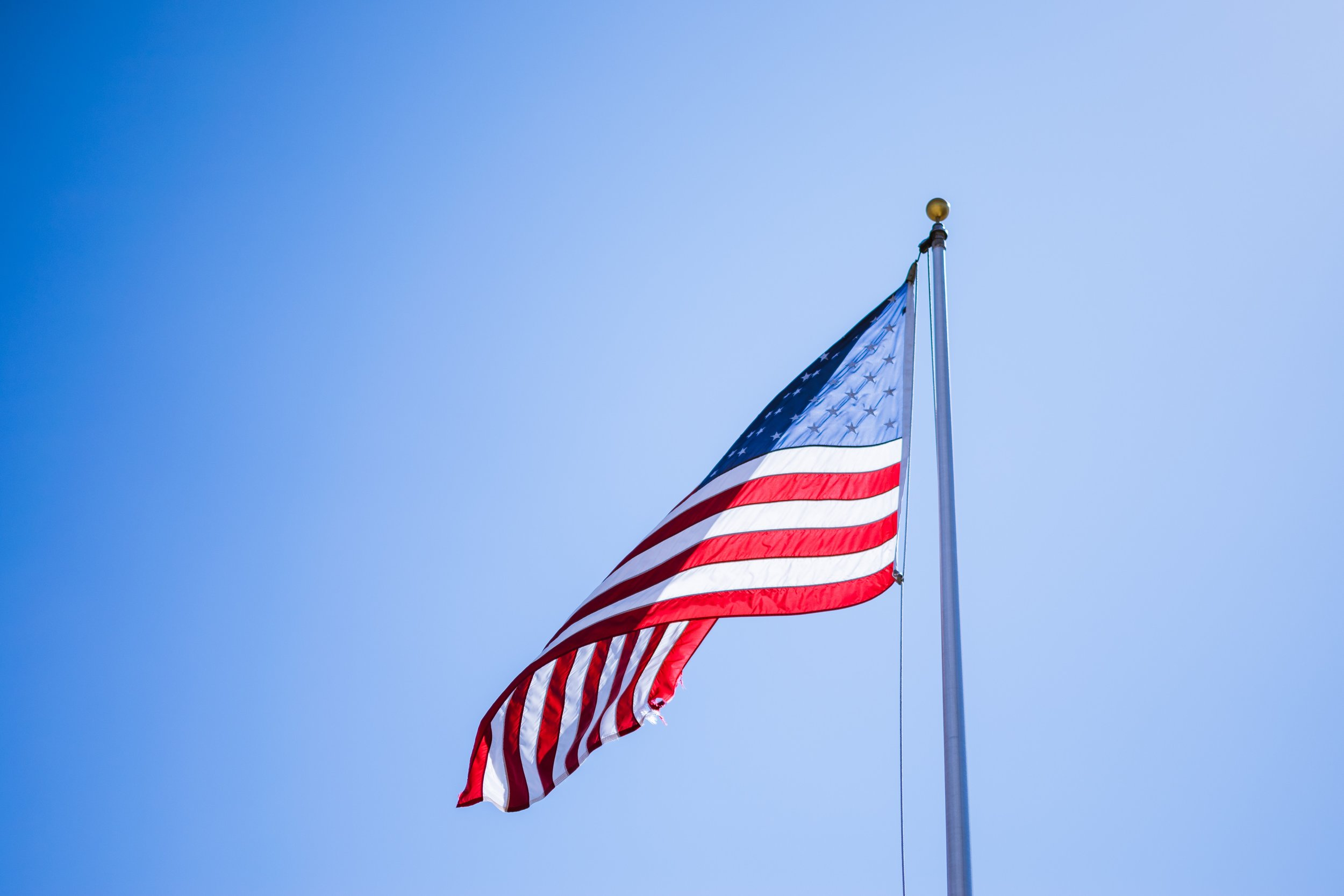 america-american-flag-blue-sky-951382.jpg
