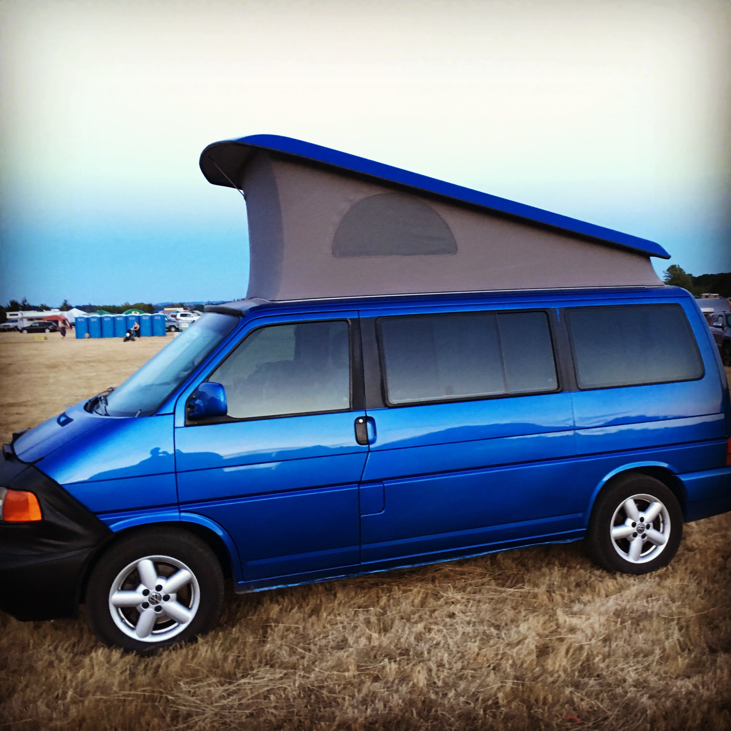 VW Weekender Specs: - -Year – 2001-Guests – up to 4 (sleeping on bed and loft)/ 7 (total in cab driving)-Engine – 204 Horsepower 2.8 L V6-Transmission – Automatic-Length – 15 1/2 feet-Beds – Queen and Full-Gas - Premium Unleaded-Pull Down Queen Bed-Pop-Top with Sleeping Loft-Bluetooth stereo system-Pull-out Interior Table-Under Seat Battery Powered Cooler-Privacy Curtains-Interior Lighting