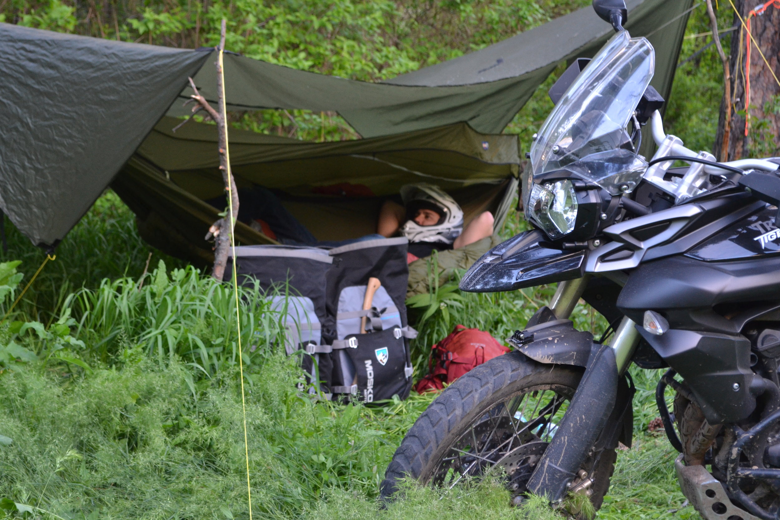 This is a Warbonnet Hammocks, tarp and quilt set up. Warbonnet is dedicated to preserving the wild lands we enjoy.  Using the hammocks really helps leave no trace and is compact and very convienent for the Adventure Motorcyclist.