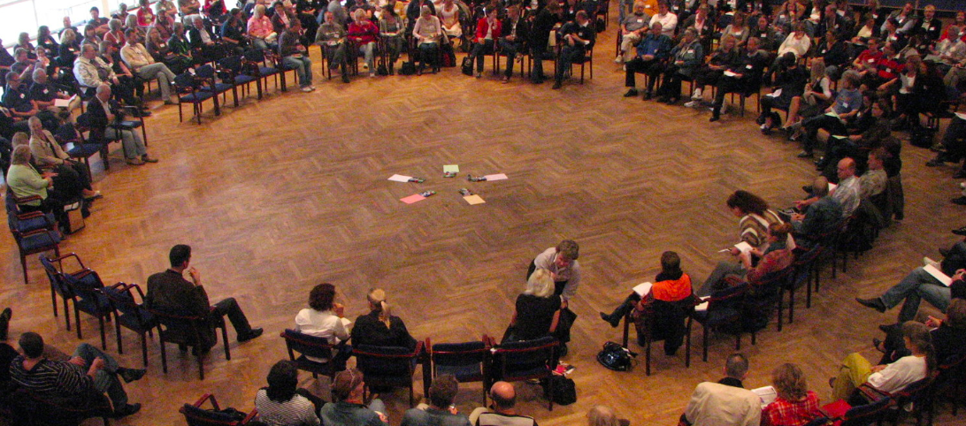 Open Space Technology Meetings are held in circles, all information to be dealt with during the meeting is brought in by participants by walking to the center of the circle, writing a topic, announcing it to the group and placing it on a grid indicating time and place to meet so people know where to find one another. All topics people choose to post and lead are welcome.