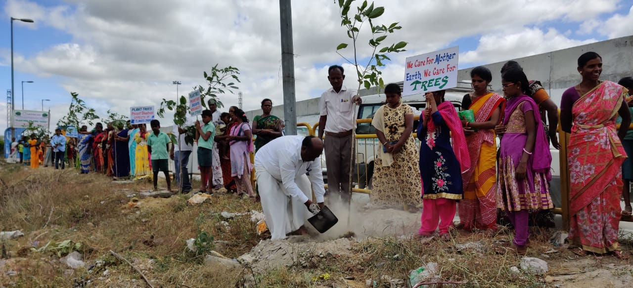 Village Councillor planting the tree .jpg