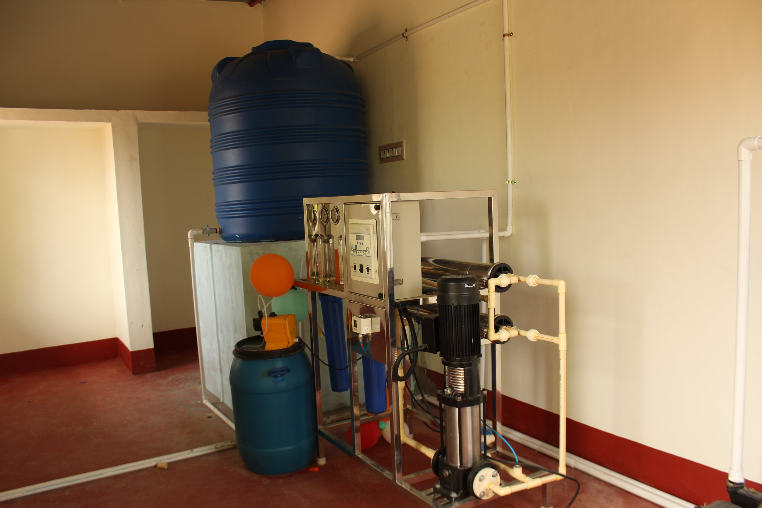 Photo of a purified drinking water plant, In another facility that Salt of the Earth donations support.