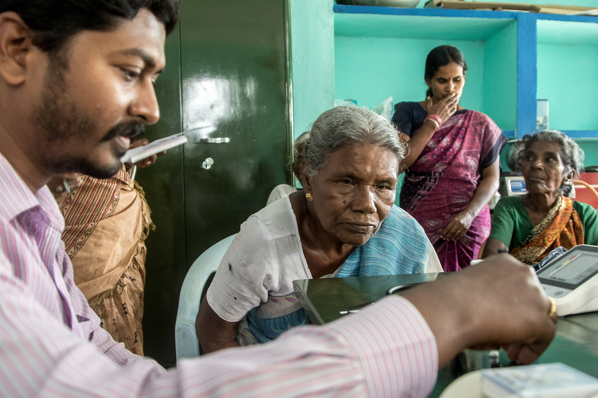 Dr Sudhakar sees to a patient in a rural village