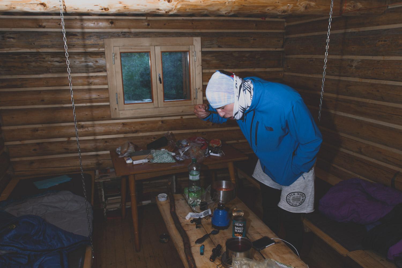 SIMK man eating in a cabin
