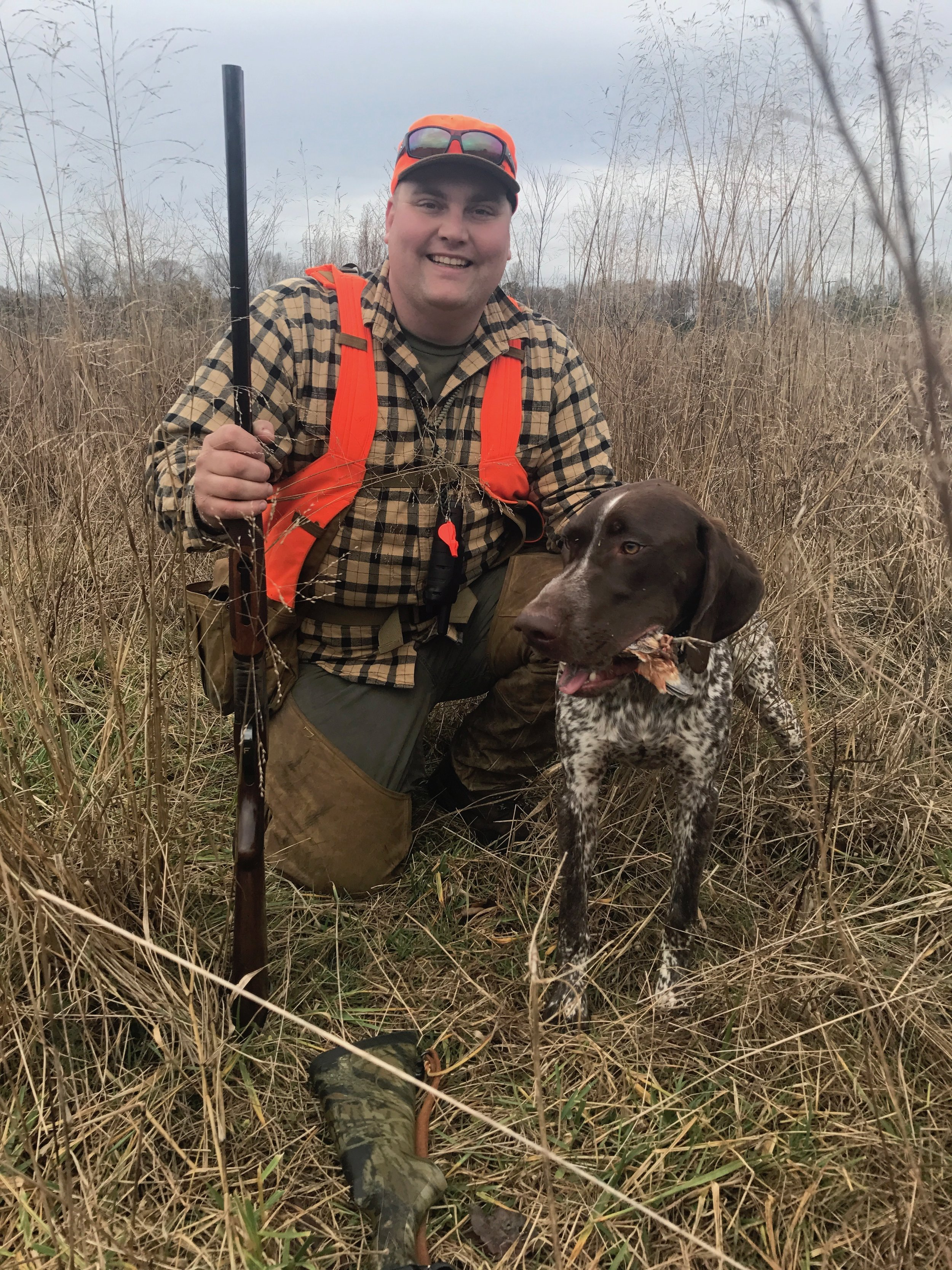 The owner of Shoot to Thrill Kennels, Jon Hensen with his male German Shorthaired Pointer Jackson on a wild quail hunt in Virginia.