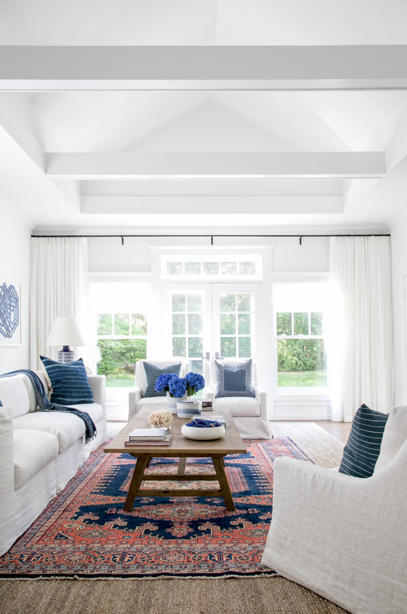 03. East Hampton New Traditional by Chango & Co - Living Room Side Afterpsd.jpg