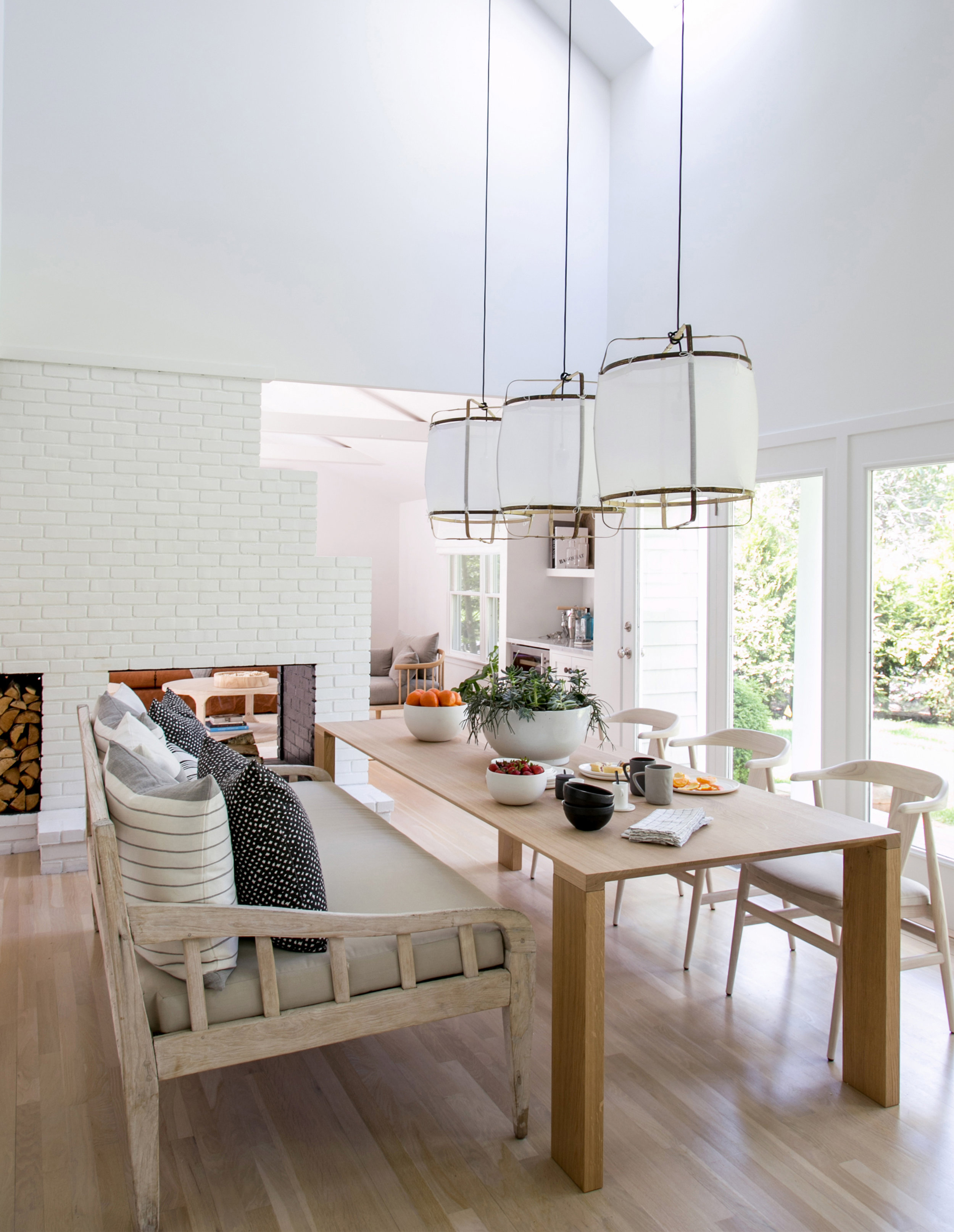 02. East Hampton Post-Modern by Chango & Co. - Dining Area & Fireplace After.jpg