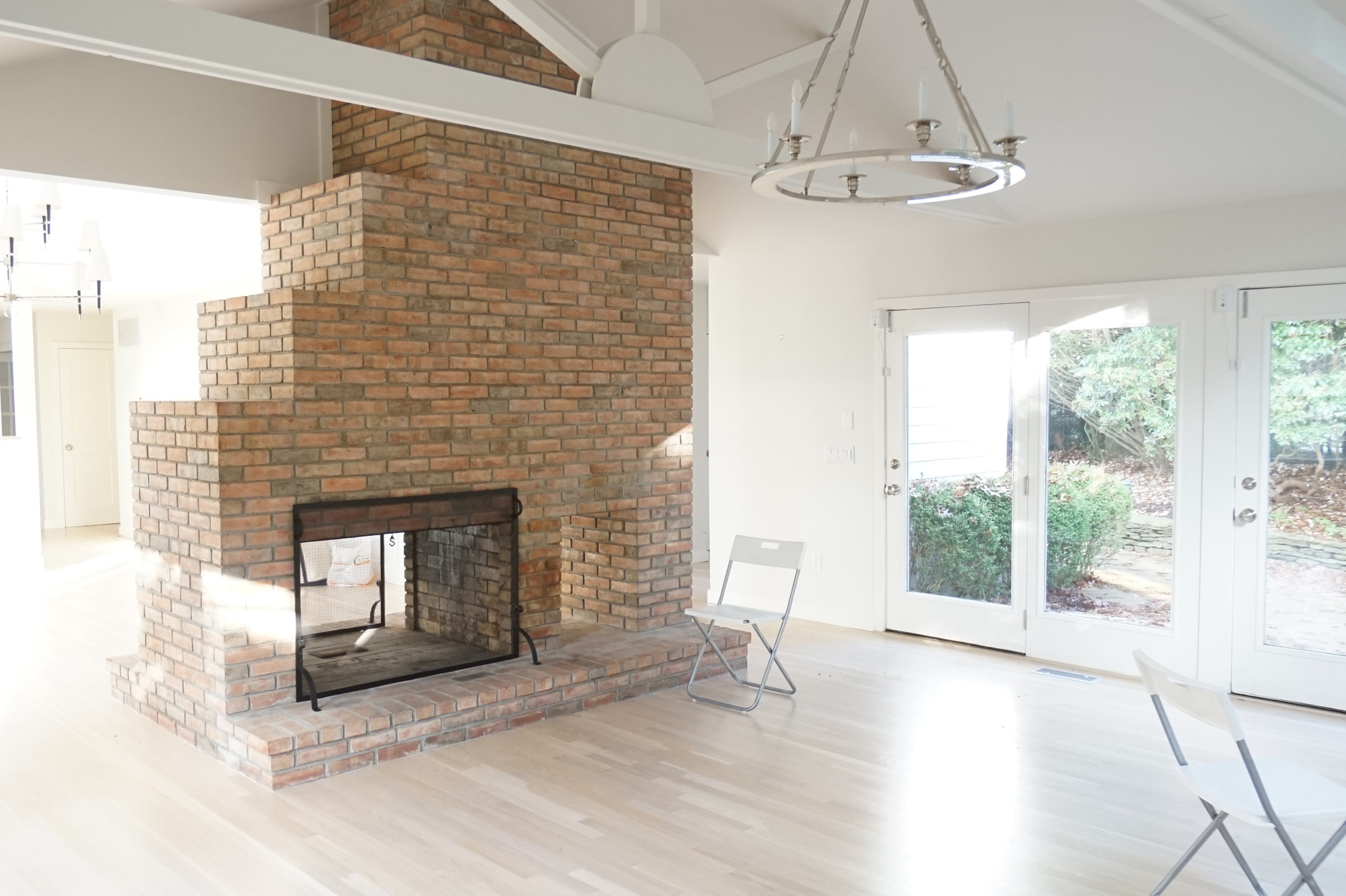 11. East Hampton Post-Modern by Chango & Co. - Living Room Fireplace Before.jpg