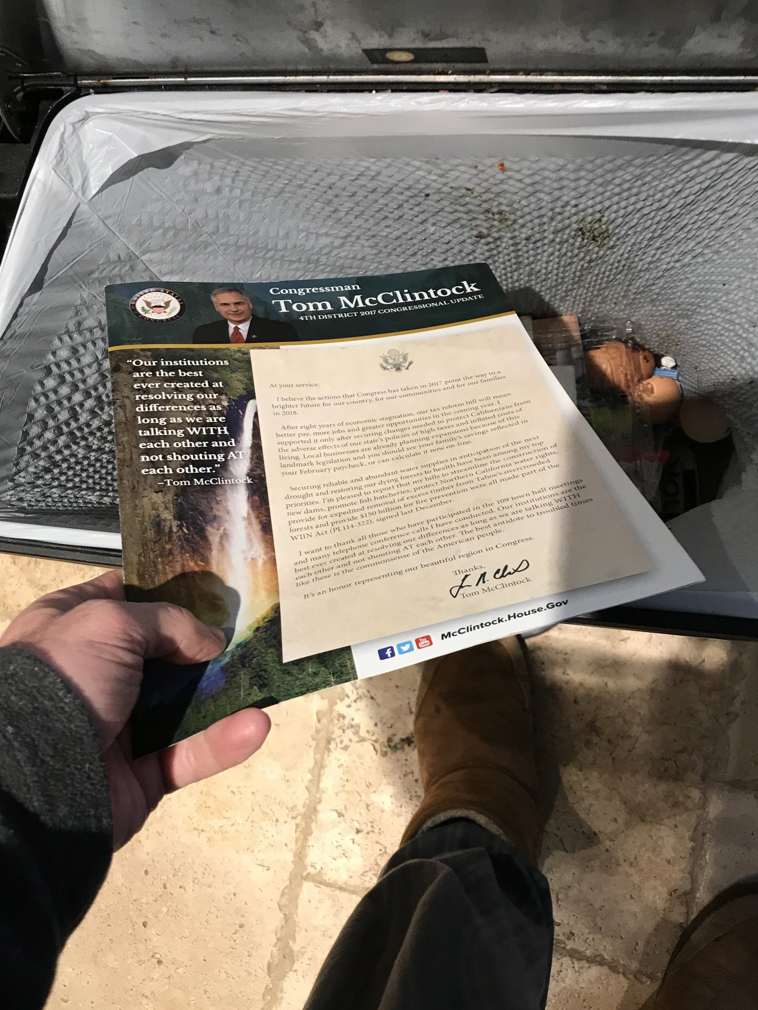 McClintock brochure in the trash can