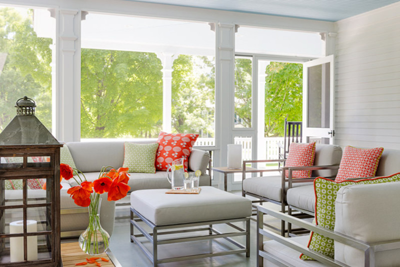 An inviting screened porch that flows from the front porch of a recent renovation by Ramsay Gourd Architects.