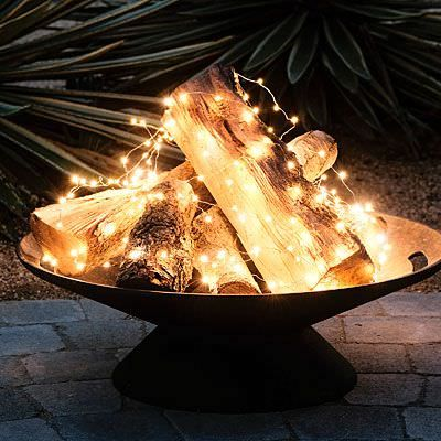Fairy lights mixed with real wood is a winner