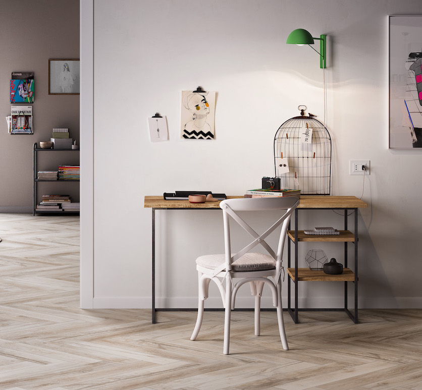 If you're lucky enough to have the space... - An open home office area like this is a lovely option. The complementing shades of wood from the floor to the desk work really nicely and are beautifully offset by the pop of green of the wall light.Image via Gemini Tiles