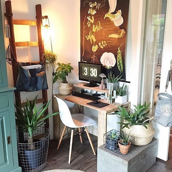 Bring nature into your space. - From the poster to all the real things, this workspace is definitely winning when it comes to bringing the outside in!Image via Workspace Goals on Pinterest.