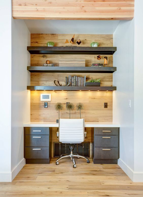 Wonderful wood! - The continuation of the wooden floor on to the wall and even the ceiling makes this home office a truly stylish corner of the home.Image via Pinterest