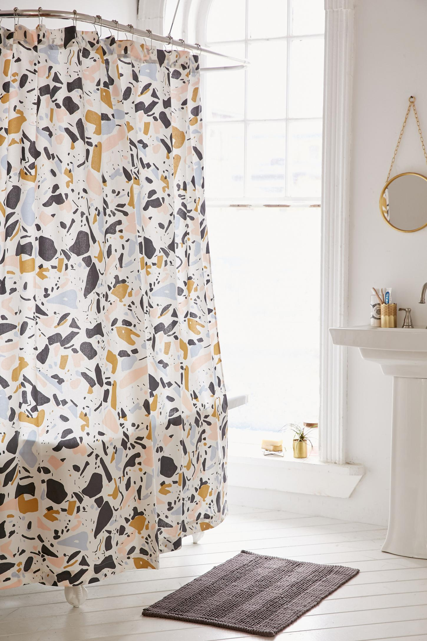 A budget (and commitment) friendly option, this terrazzo print shower curtain from Urban Outfitters will bring the trend to the bathroom with ease. - Image via Pinterest