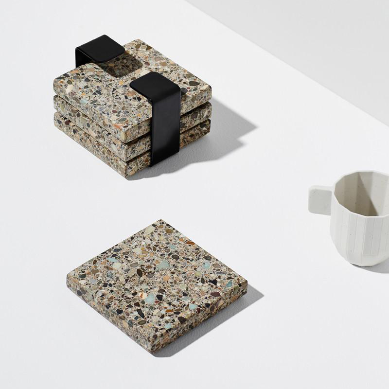 Terrazzo Trivits - Habitat is a 4-piece trivet set, made from natural, earthy Terrazzo stone. Finished with a steel band to house them when not in use, they make a textural addition to any tabletop. $69.95 for 4Available at www.onthesly.com.au