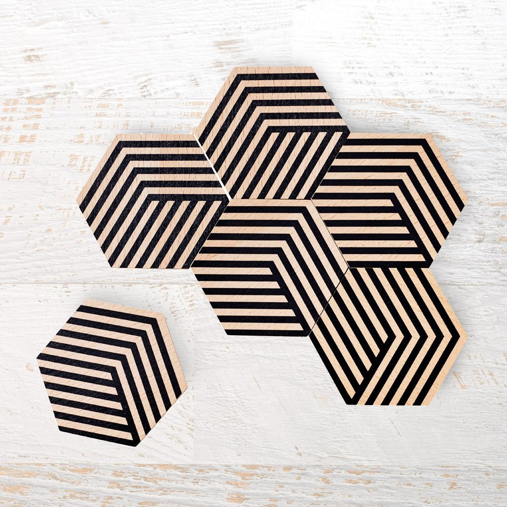 Geometric Coasters - This set of six coasters can be artfully arranged to form a tiled trivet. The illusion of 3D through colour and geometry allows for endless permutations, encouraging playful mosaic-building on your table.$29.00Available at www.isawthis.com.au