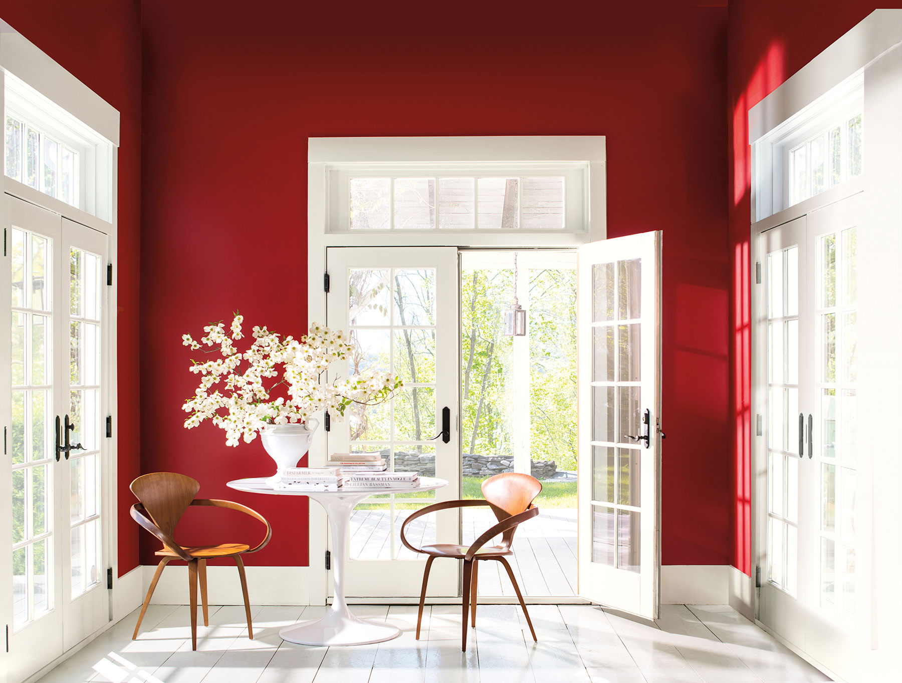 """3. Benjamin Moore - Caliente - Another contender for Colour of the Year 2018 is leading American paint brand, Benjamin Moore. In a bold contradiction to the earthen hues of Heart Wood and Fire Within (although actually staying within the same colour family), Caliente has been revealed as Benjamin Moore's headlining colour. Described as a """"warm, enveloping and seductive hue"""" this powerful red tone is not one for the colour shy! When paired with crisp white, the red's vibrancy pops off the wall with maximum impact, but for a more homely look, the richness of Caliente can be toned down by teaming with natural wood and other complementary colours in the brand's corresponding palette of 22 enlivening hues.Ellen O'Neill, Benjamin Moore Director of Strategic Design Intelligence:""""Strong, radiant, full of energy, Caliente is total confidence. It's the signature colour of a modern architectural masterpiece; a lush carpet rolled out for a grand arrival; the assured backdrop for a book-lined library; a powerful first impression on a glossy front door. The eye can't help but follow its bold strokes. Harness the vitality.""""Prices start from £20.50 for 0.94L of paint from the Regal Select Flat rangewww.benjaminmoorepaint.co.uk"""