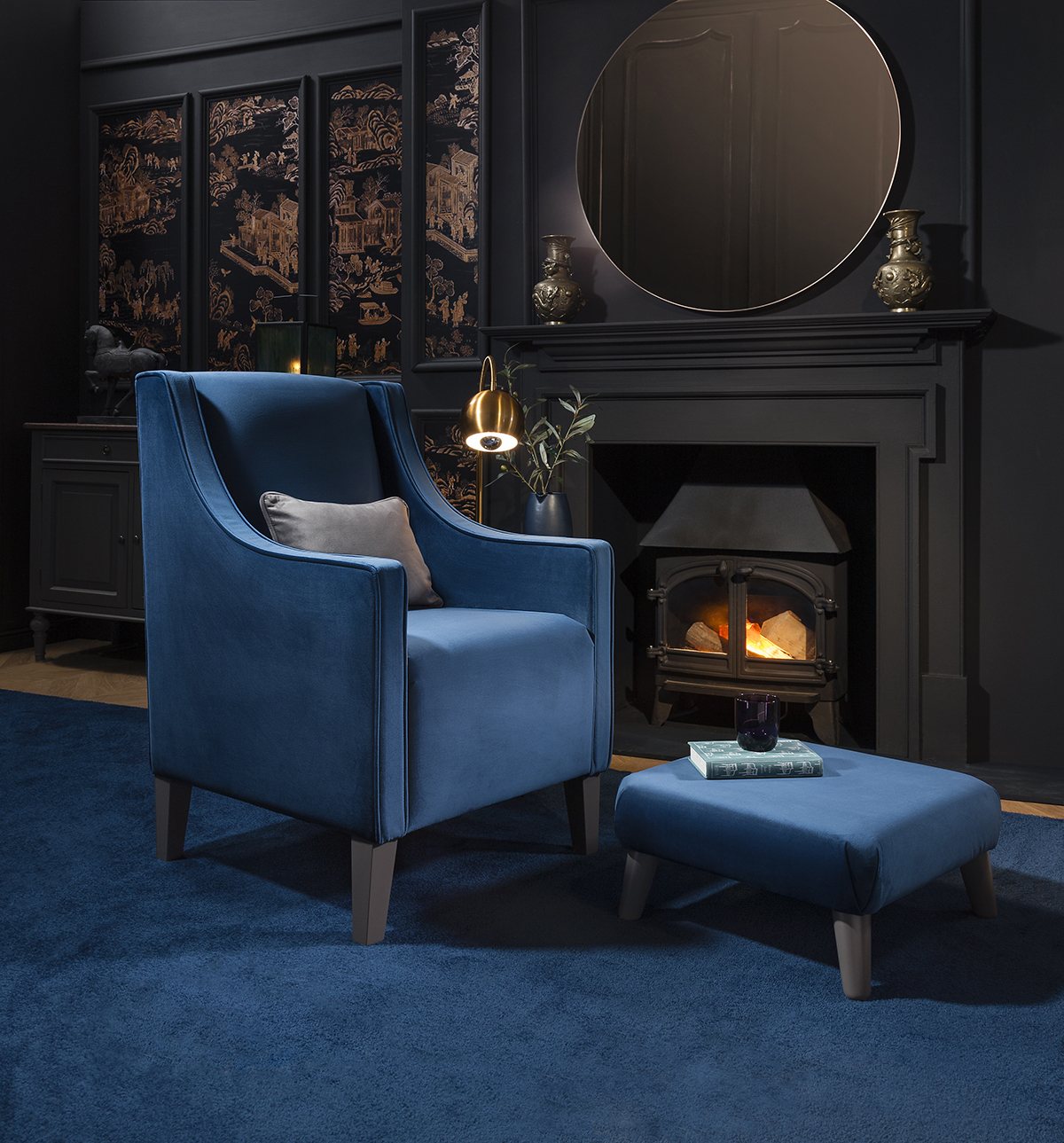 Furniture favourites - What better way to stay cosy than by curling up in your favourite chair next to an open fire or roaring wood burner? The Eastergate armchair from Mood Collections' Opulent range is upholstered in rich Petrol Blue velvet, boasting sleek, clean lines, curved arms and piping detail, finished with dark slate grey legs. Currently priced at a discounted rate of £460.75, the aesthetically rich and supremely snug seat can be purchased online at www.moodcollections.co.uk