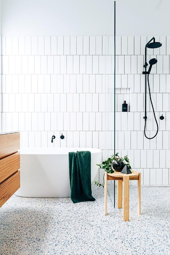 12-vertical-tiles-and-a-terrazzo-floor-with-blue-touches-that-add-interest.jpg