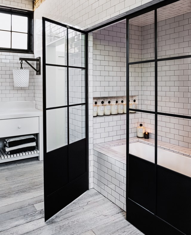 Monochrome Dream. - We are in love with the black French doors - used here as a shower enclosure - which act as the prefect contrast to the white fixtures in the rest of the room. Despite being devoted to her favourite black and white colour scheme, the texture of brick soon grew on her until she eventually had the ones you see here shipped across from Chicago.